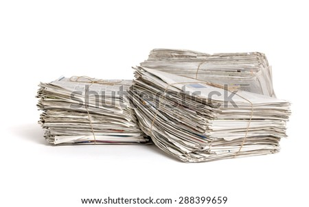 Three bundles of newspapers on a white background - stock photo