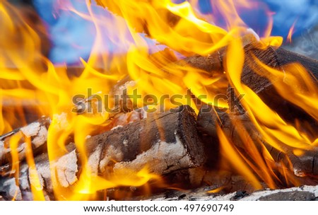 three burning billets in hot stove wood fire heat