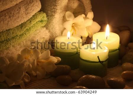 three burning candles in the dark - stock photo