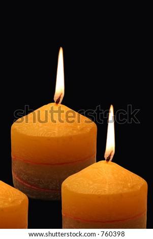 Three Burning candles, isolated on black - stock photo