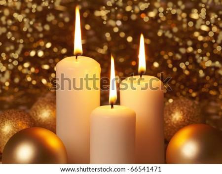 three burning christmas candles - stock photo