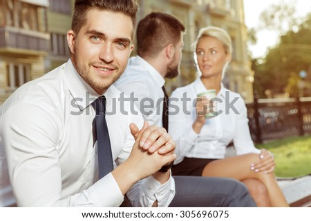Three Business Colleagues Outdoors. Three friends at the coffee breaks - stock photo