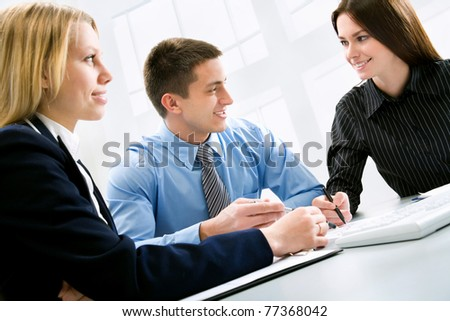 Three business colleagues working together