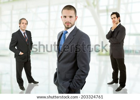 three business men portrait at the office - stock photo