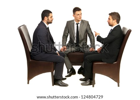 Three business men sitting on chairs together and having conversation isolated on white background