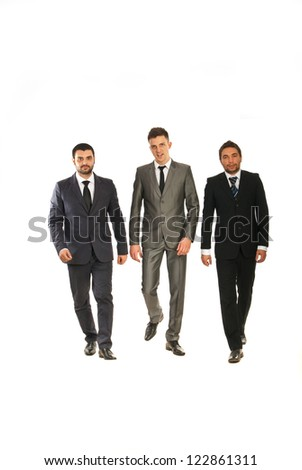 Three business men walking isolated on white background - stock photo