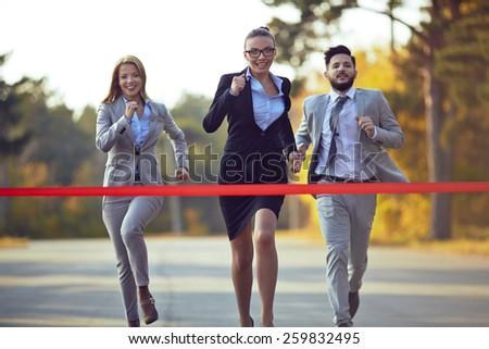 Three business opponents competing in cross - stock photo