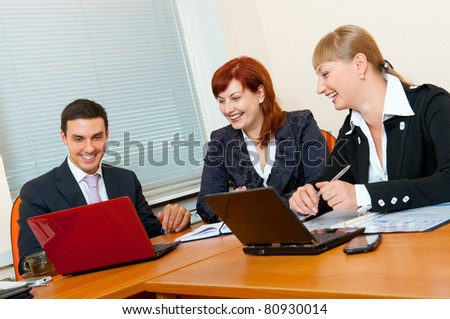 Three business people are meeting in the office - stock photo