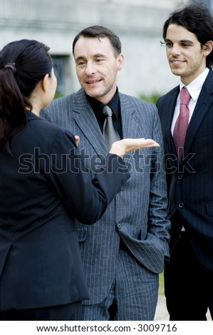 Three business people having a discussion outside