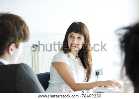 Three business people in a meeting at office - stock photo