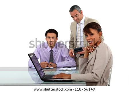 Three business people in meeting - stock photo