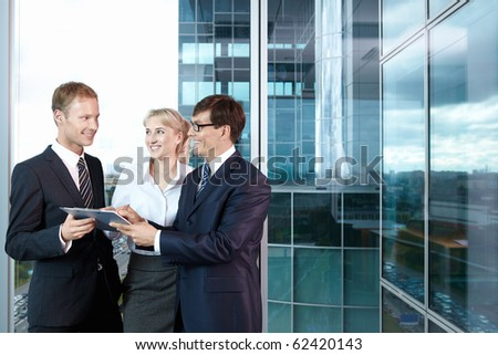 Three business people in the office - stock photo