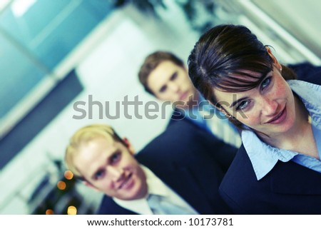 three business people looking towards camera and walking up stairs - stock photo