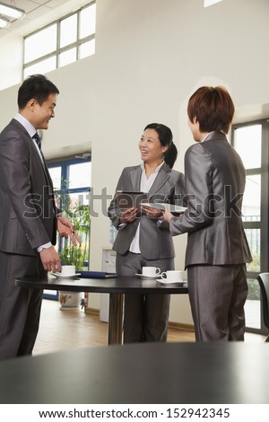 Three business people meeting in company cafeteria - stock photo