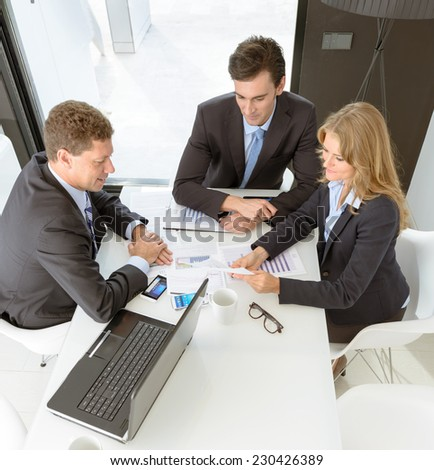 Three business people on a meeting