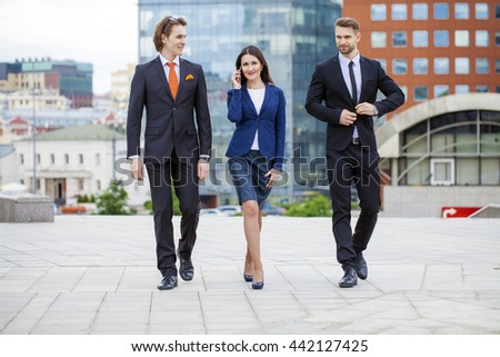 Three Business people outside office - stock photo