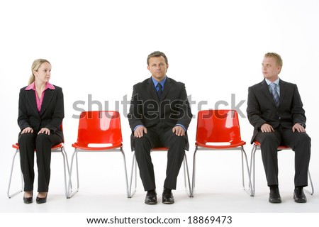 Three Business People Sitting On Red Plastic Seats