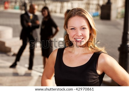 Three business people with one woman as focus. Horizontally framed shot. - stock photo
