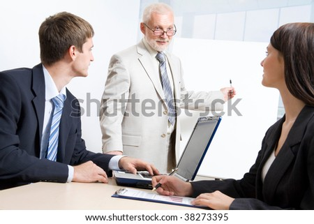 Three business people working in the office