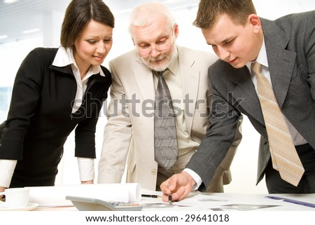 Three business people working together - stock photo