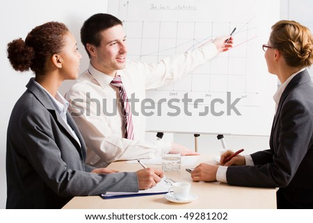 Three business people working together.