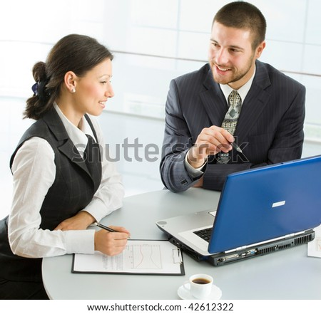 Three  business people working with lap-top