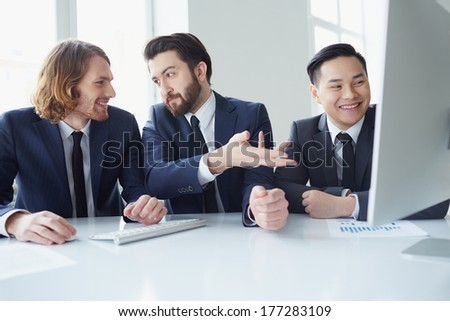 Three businessman planning business in meeting room - stock photo