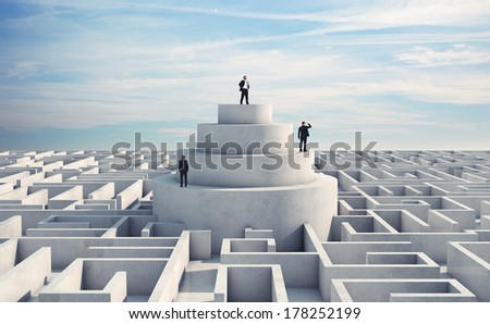 Three businessmen in the middle of a labyrinth - stock photo