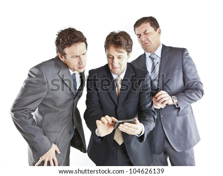 three businessmen looking at a smartphone - stock photo