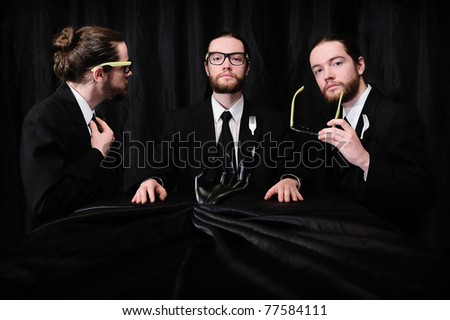 Three businessmen meeting at the table