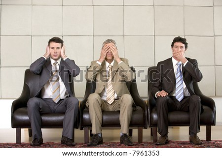 "Three businessmen showing the concept ""hear, see and speak no evil"""