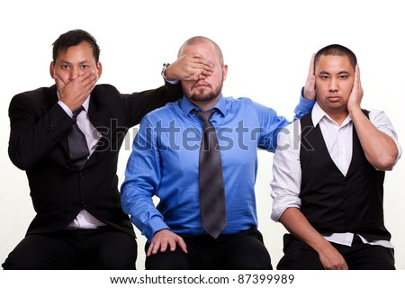 Three businessmen - Three wise moneys. See no evil, hear no evil, speak no evil - stock photo