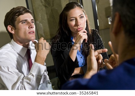Three businesspeople conversing - stock photo
