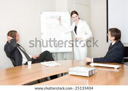three businesspeople discussing different questions - stock photo