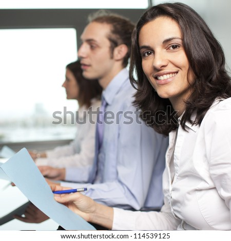 three businesspeople interacting at meeting - stock photo