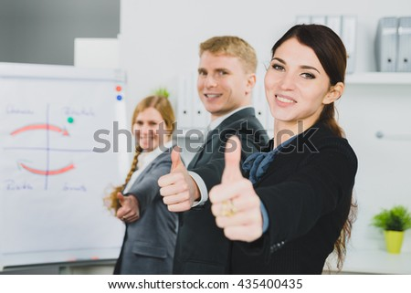 three businessperson standing in line in office