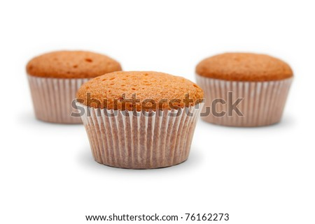 Three cakes in paper packing isolated on white - stock photo