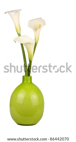 Three Calla lilies in a green vase - stock photo
