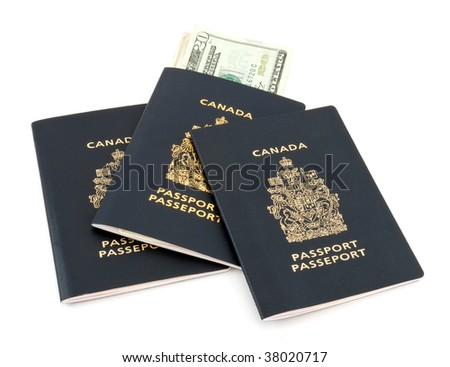 Three Canadian passports with USA currency isolated on white.