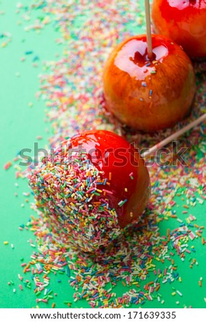 three candied apples with sugar sprinkles - stock photo