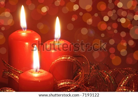 three candle on red background
