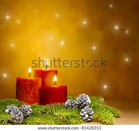 Three candles decorated in a festive Christmas decoration, with space for advertising text - stock photo