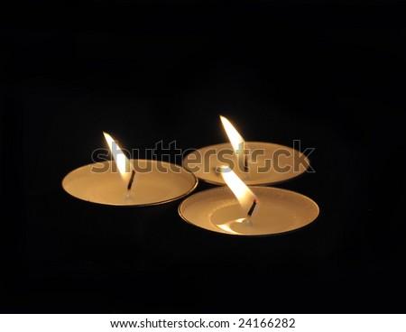 Three Candles in catholic church - stock photo