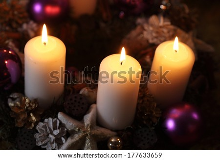 Three candles with christmas decoration