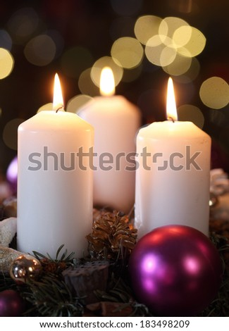 Three candles with christmas decoration - stock photo