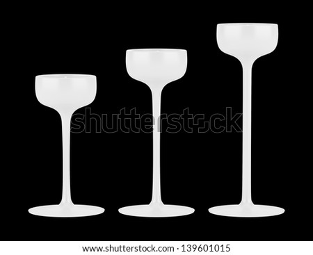 three candlesticks with small candles isolated on black background
