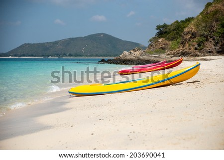 Three canoes on the beach - stock photo
