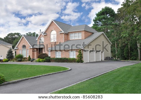 Three Car Garage Suburban Luxury Home in Residential District with Circular Driveway