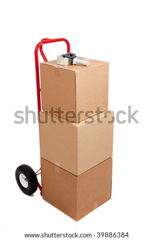 Three cardboard moving boxes on a red hand truck with tap gun on a white background