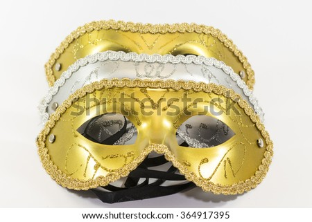 Three carnival masks overlapping